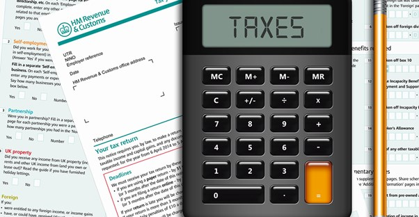 Photo of a calculator and accounting forms