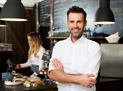 Restaurant owner standing in restaurant