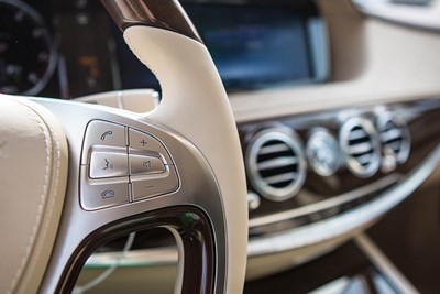 the driver's seat of a luxury car