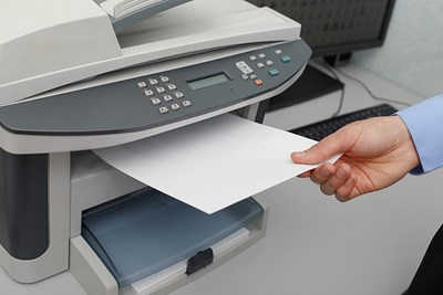 Person taking paper from a printer