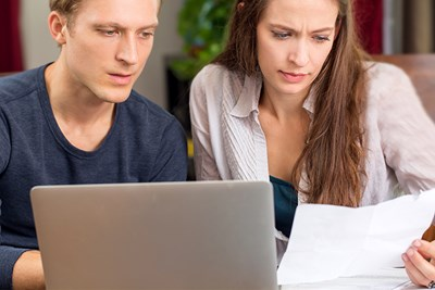 couple looking over articles of organization
