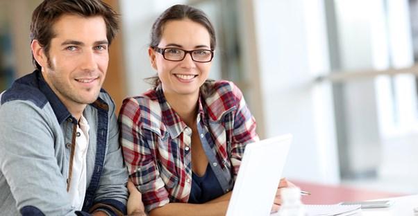 Couple looking into online business schools