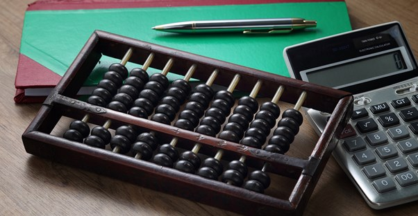 Abacus and a calculator representing merchant accounts