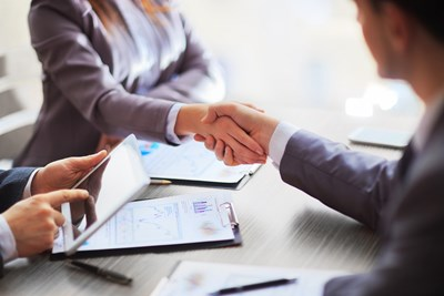 Businesspeople shaking hands over a business account deal