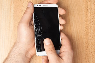 phone with a broken screen that would be repaired by cell phone insurance