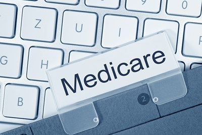 Label of medicare sitting on a keyboard