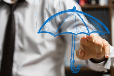 a man pointing at a drawn picture of an umbrella to explain what professional liability insurance is and what it protects