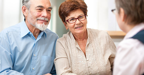Older couple consulting with a life insurance agent