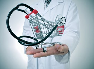 A doctor holding an image of a stethoscope in a shopping cart to represent shopping for health insurance that includes five necessary services.