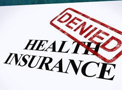 A red denied stamp over the words Health Insurance