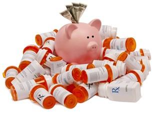 Piggy Bank on a mountain of pill bottles