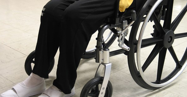 Elderly person in a wheelchair using long term care insurance