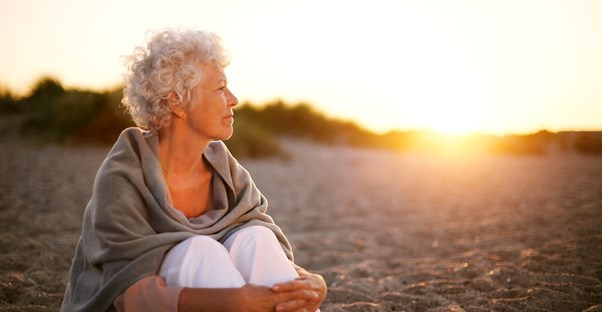 Woman looking off into the distance, contemplating long term care insurance