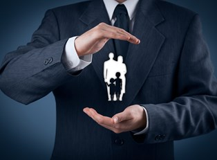 Man holding a representation of a family affected by unclaimed life insurance