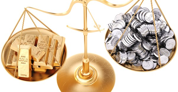 Scale weighing gold and silver for investments