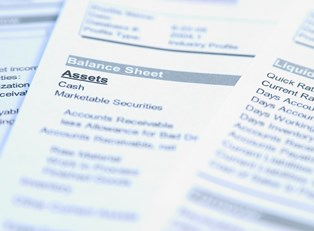 Close up of an asset balance sheet provided by an asset management firm