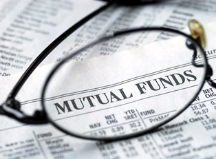The lens of a pair of glasses magnifying the phrase mutual funds to represent how you should look closely at mutual funds to decide if they are a good investment for you.
