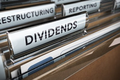 File folder tabs labeled dividends, restructuring, reporting
