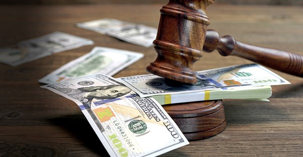 gavel on top of money in court room