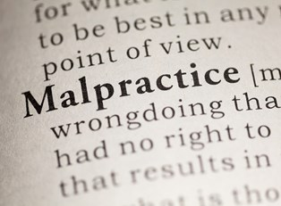 Malpractice highlighted in a dictionary page