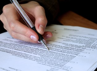Person filling out legal forms