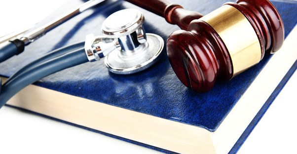 A gavel and a stethoscope laying on a legal book to represent the idea of accident injury lawyers