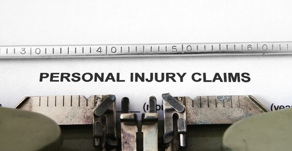 Personal Injury Claims typed on a piece of paper in a typewriter to display the seriousness of these claims and support hiring accident injury lawyers
