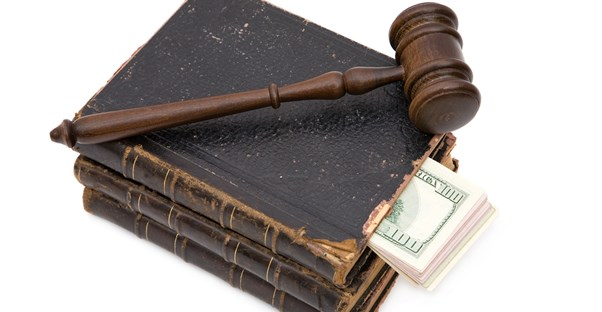 Law books, money, and a gavel