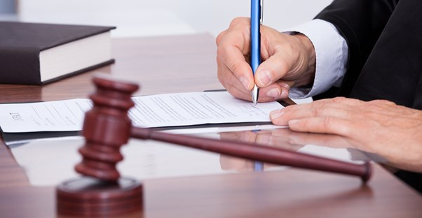 Client signing a mediation settlement agreement