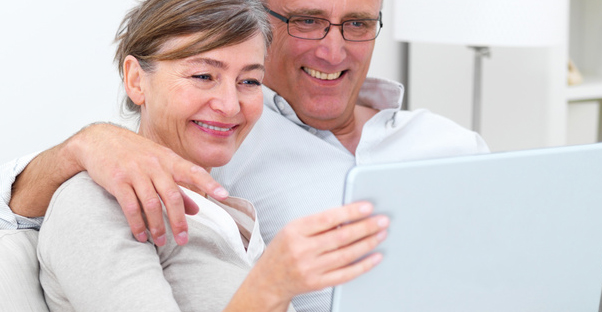 Retiring couple examining their 401k plans