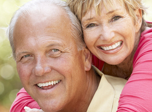 Happy senior couple considering a reverse mortgage