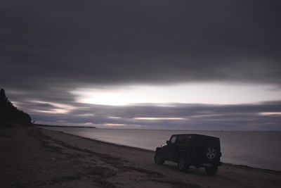A Jeep SUV driving on beach