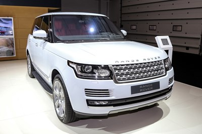 A luxury land rover sitting in a show room