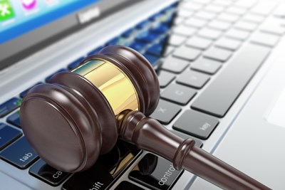 Gavel on top of a computer used to access online government auctions