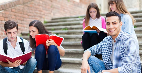 students studying outside at community college