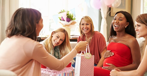 mom opening gifts at baby shower