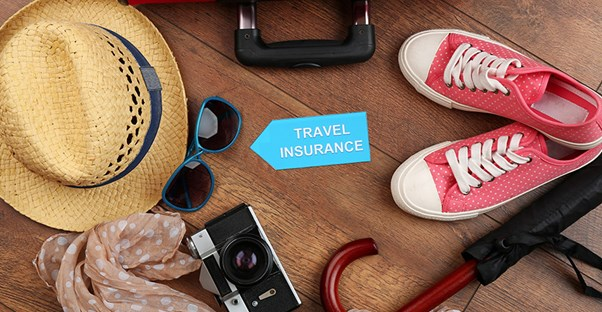travel insurance with items packed for vacation
