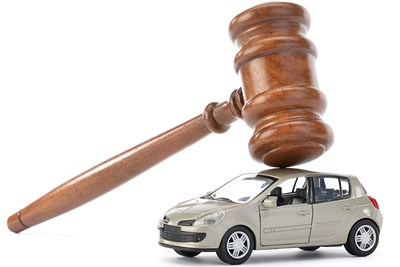 a gavel resting on a toy car showing that cars from auctions are a risk vs. reward