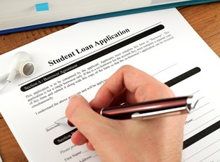 Student signing a student loan agreement