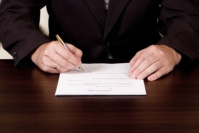 person signing over their beneficiary