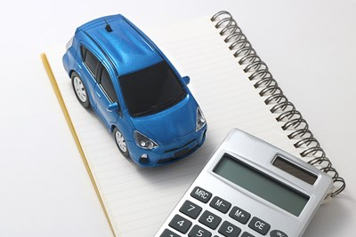 Car, calculator, and notepad. Cost of Living.