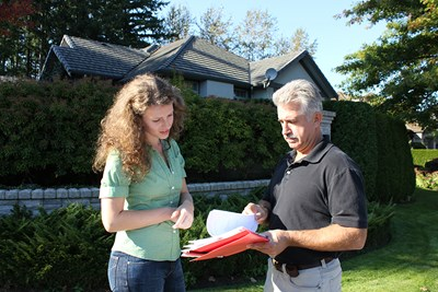 Man and woman looking over contract. Home Inspection.