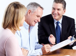 Couple working with a financial planner to plan for retirement