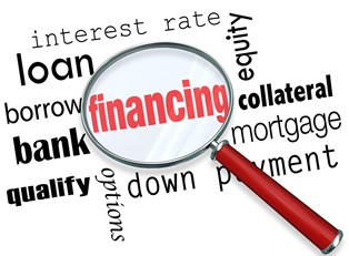 Word cloud with magnifying glass highlighting financing