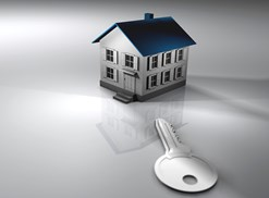 small house looming over a key