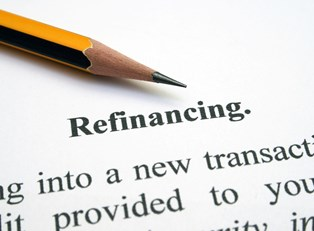 Sharpened pencil pointing to refinancing