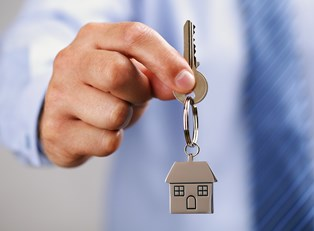 A lender holds the key to a potential new home.