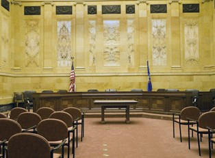 a courtroom where people with juris doctor degrees use legal terminology
