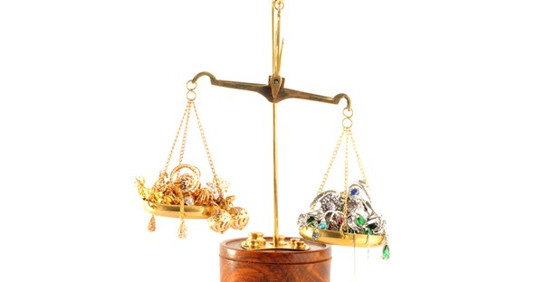 gold being weighed on a scale