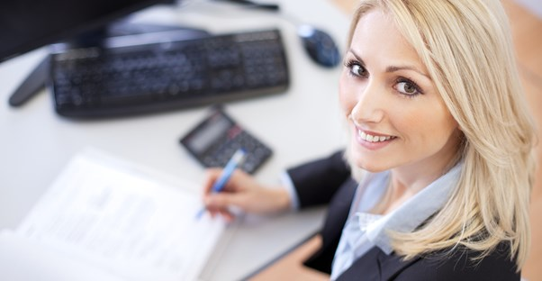Woman smiles after hiring payroll service